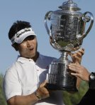 Y.E. Yang holds the PGA Championship trophy